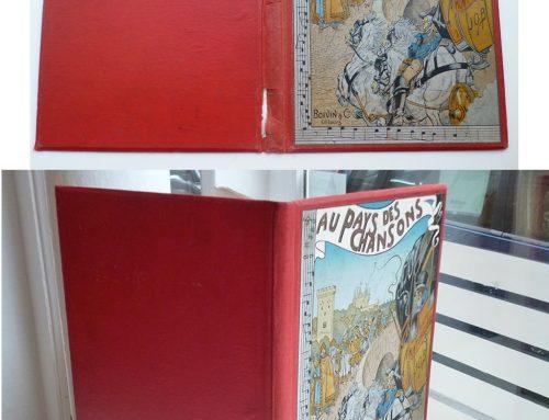"""Restauration cartonnage d'éditeur – """"Au pays des Chansons"""""""